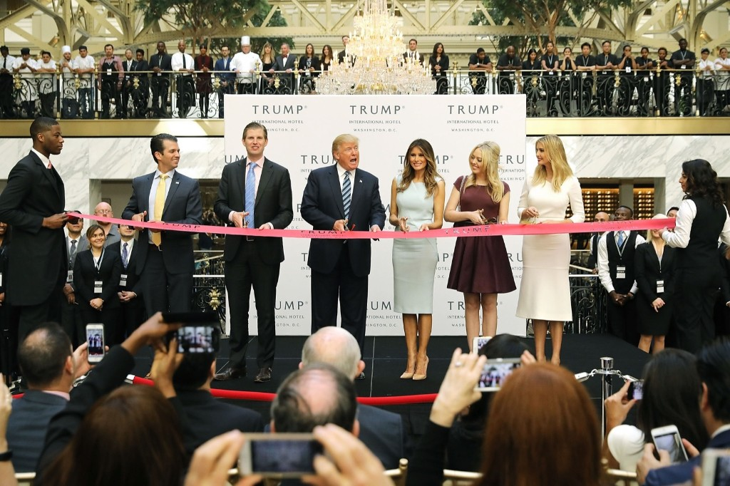 Donald Trump and his family (L-R) son Donald Trump Jr, son Eric Trummp, wife Melania Trump and daughters Tiffany Trump and Ivanka Trump cut the ribbon at the new Trump International Hotel in Washington, DC. Chip Somodevilla/Getty Images