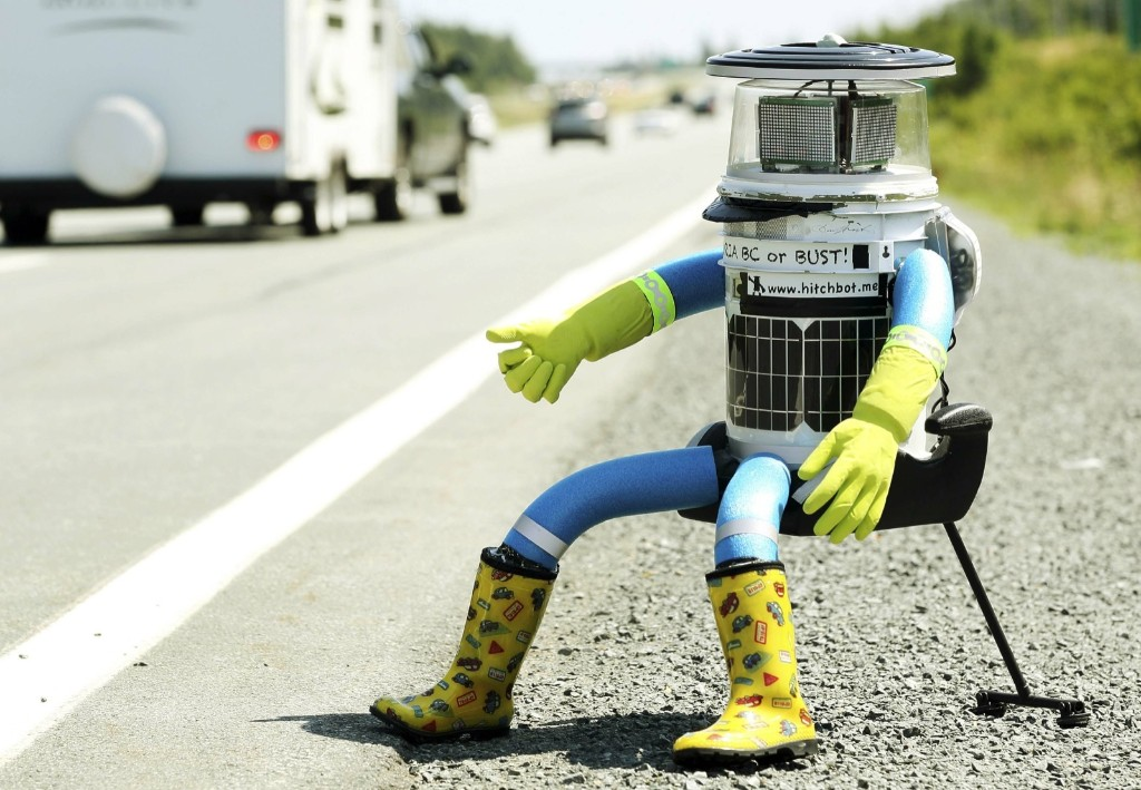 An anthropomorphic robot named hitchBOT hitchhikes on Highway 102 outside of Halifax. REUTERS/Paul Darrow
