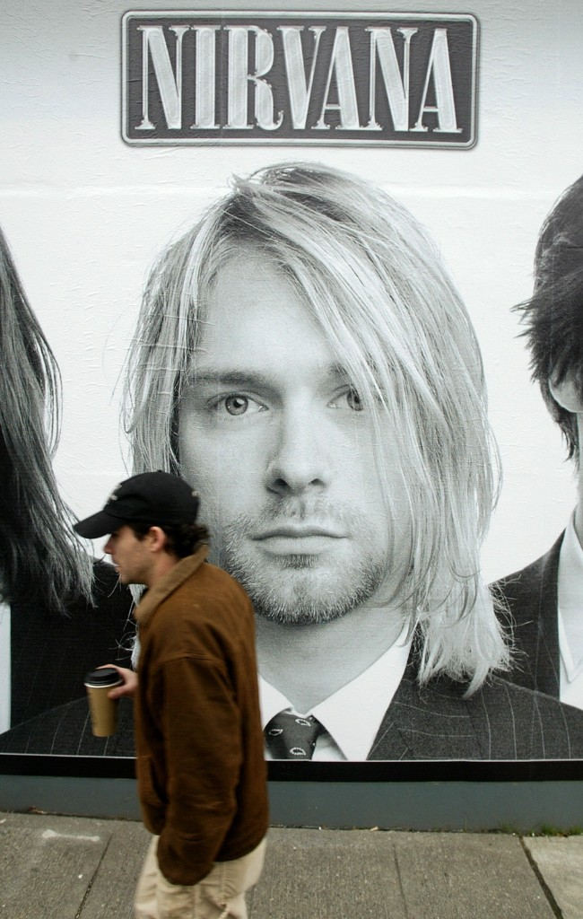 "A mural of the cover of the Nirvana box set ""With the Lights Out,"" on a wall of a record store in Seattle, in 2004. AP Photo/Ted S. Warren"