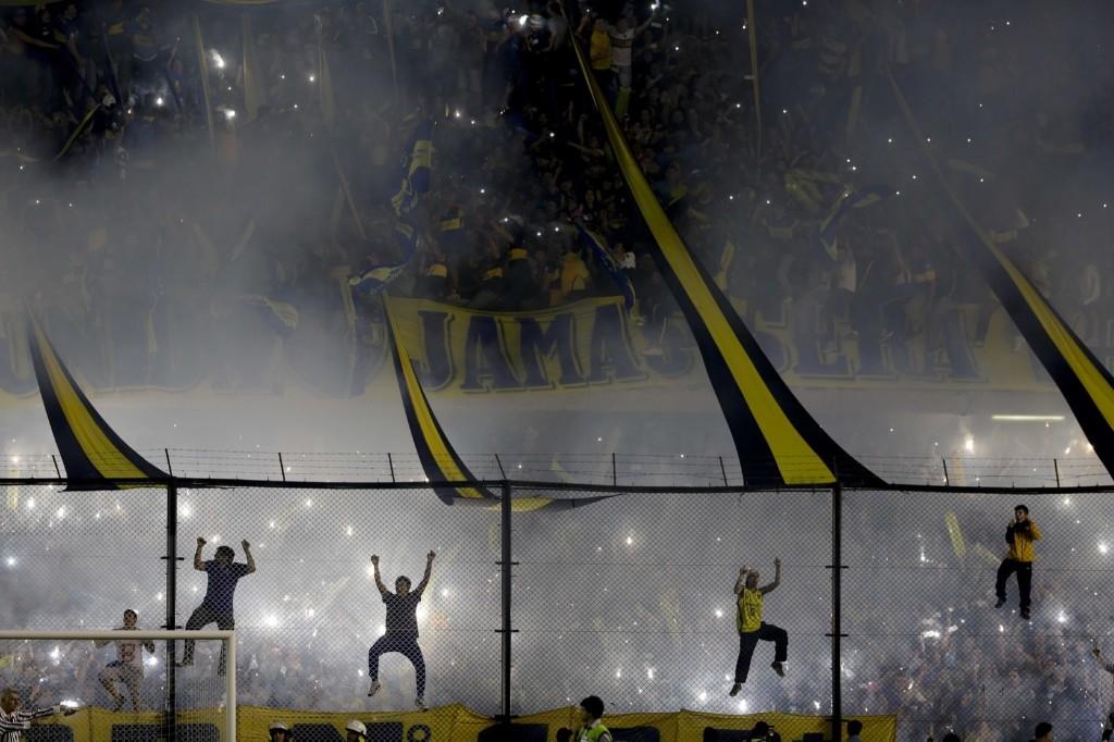 Boca Juniors fans cheer their team before a Copa Libertadores round of sixteen soccer match against River Plate in Buenos Aires. AP Photo/Natacha Pisarenko