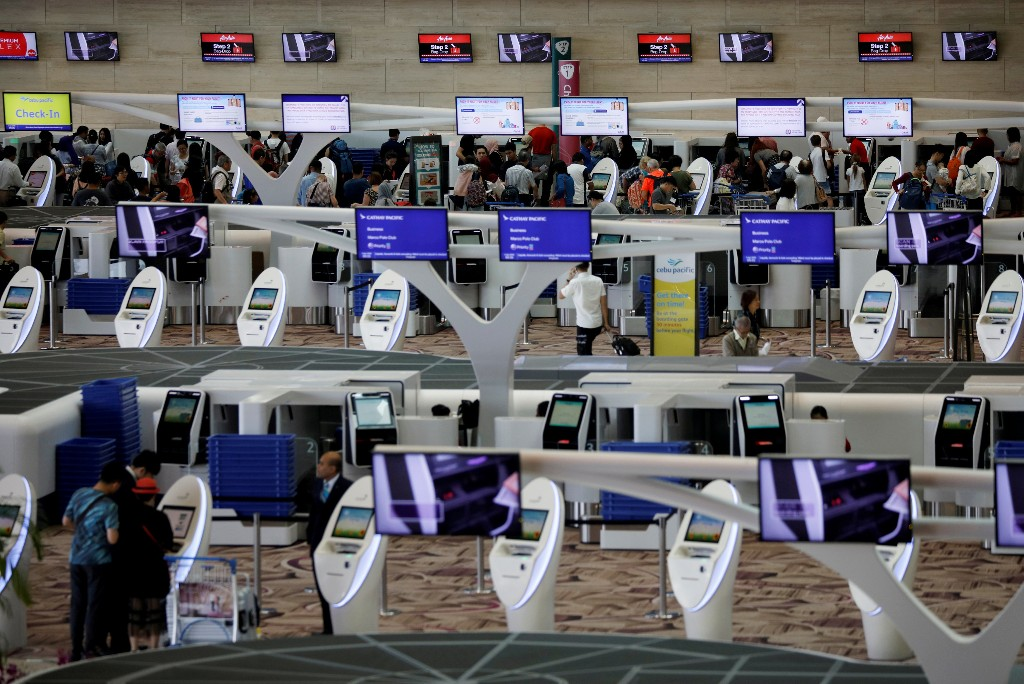 FILE PHOTO: A view of automated check-in counters at Changi Airport Terminal 4 in Singapore, April 3, 2018. REUTERS/Edgar Su/File Photo