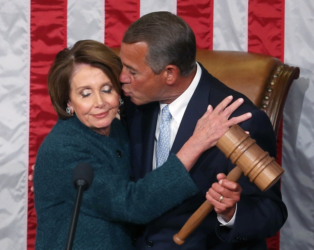 Nancy Pelosi is kissed by John Boehner as he is handed the speaker's gavel during the first session of the 114th Congress. Mark Wilson/Getty Images