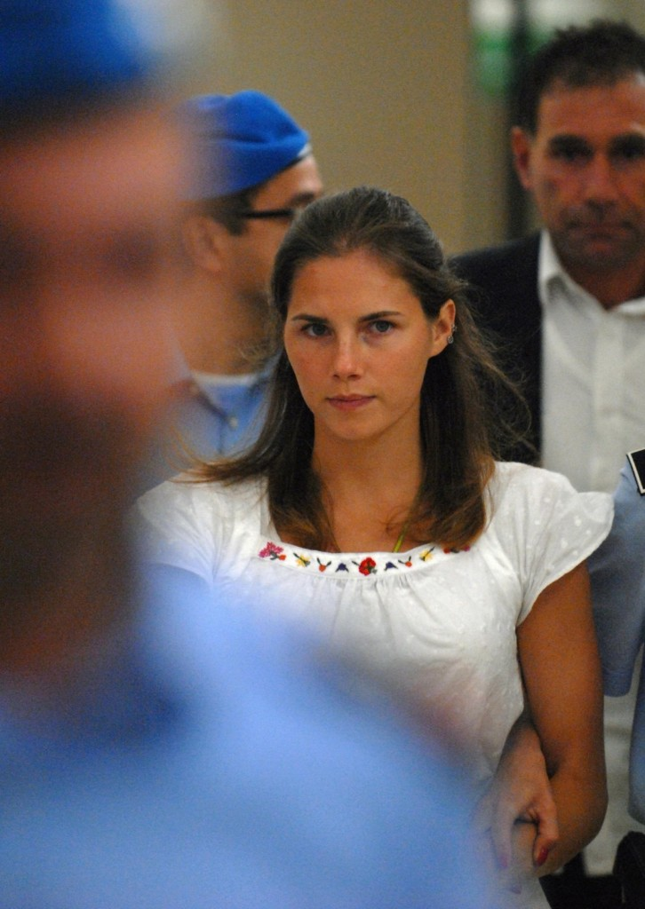 Amanda Knox is escorted by police at a court hearing in Perugia on Sept. 16, 2008. Federico Zirilli/AFP/Getty Images
