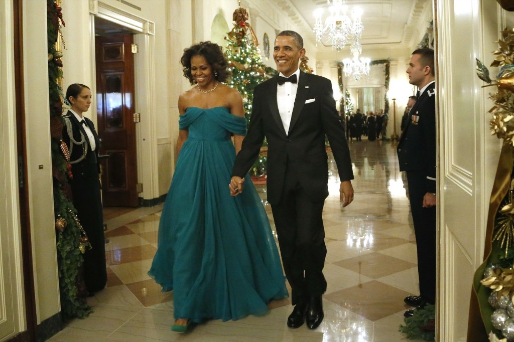 President Barack Obama and first lady Michelle Obama arrive for the 2013 Kennedy Center Honors at the White House, Sunday. REUTERS/Jonathan Ernst