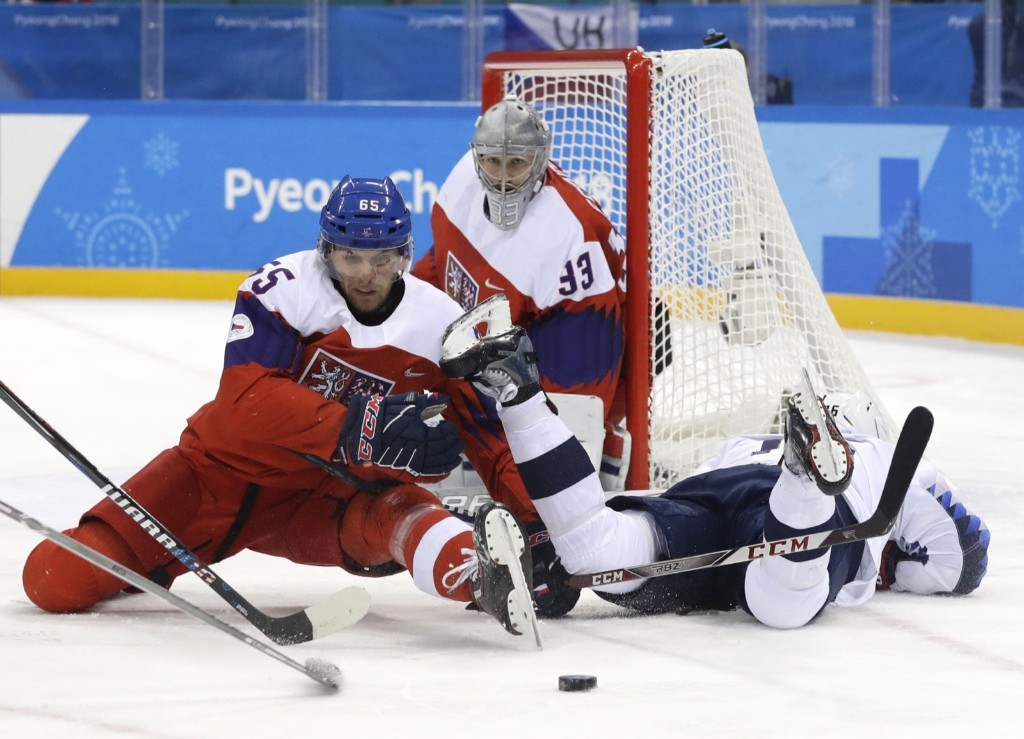Vojtech Mozik of the Czech Republic, Ryan Donato of U.S. and goalie Pavel Francouz of the Czech Republic battle for loose puck. REUTERS/David W. Cerny