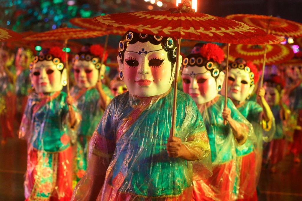 China Fuzhou Mindu Folk-Custom Art Troupe and the PA Active Ageing Council collaborate to perform the big headed doll dance during the Chingay Parade in Singapore. Suhaimi Abdullah/Getty Images