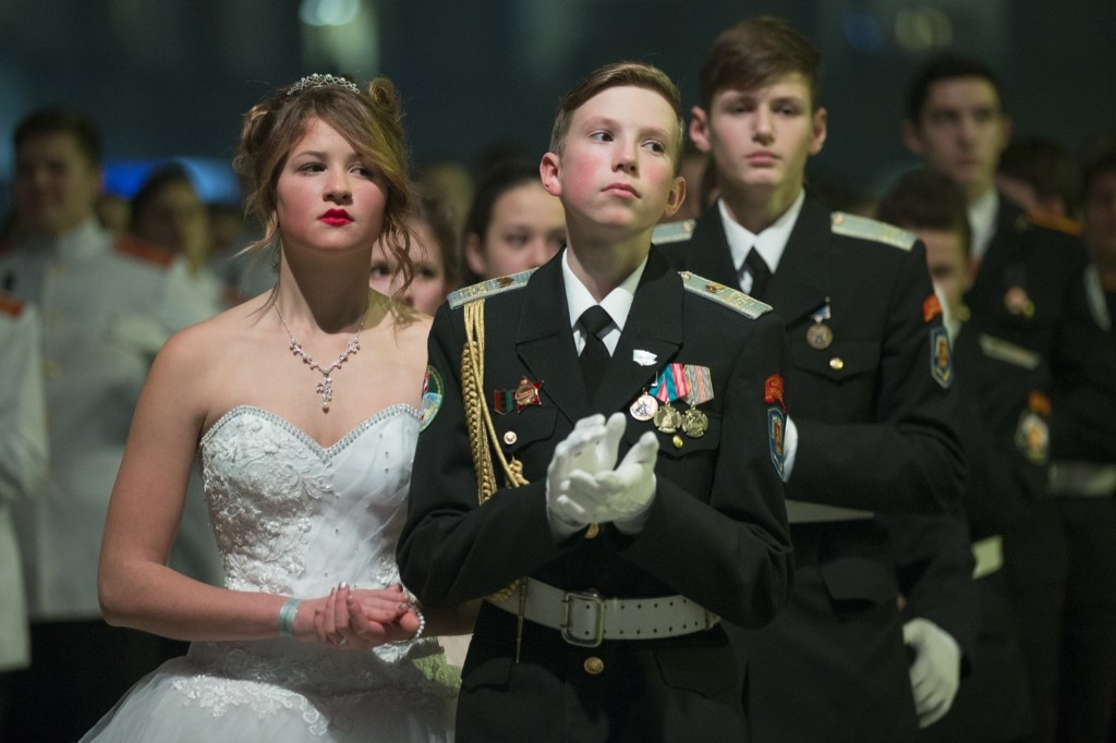 Military school students wait to dance during their annual ball in Moscow. AP Photo/Alexander Zemlianichenko