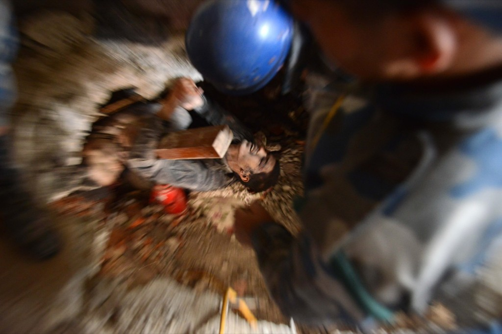 Nepalese rescue personnel help a trapped earthquake survivor in Swyambhu. PRAKASH MATHEMA/AFP/Getty Images