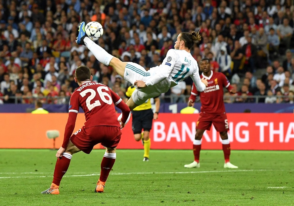 Gareth Bale of Real Madrid shoots and scores his side's second goal during the UEFA Champions League Final against Liverpool at NSC Olimpiyskiy Stadium in Kiev. Real won, 3-1. David Ramos/Getty Images