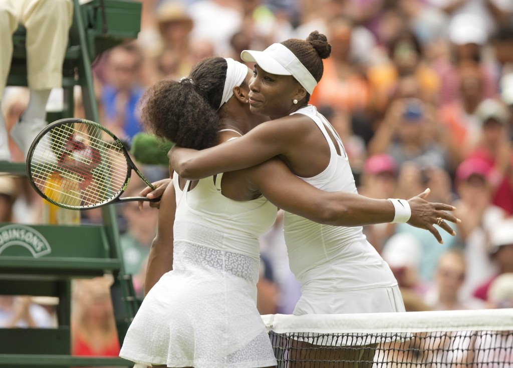 Serena Williams and Venus Williams after their match on day seven. Susan Mullane-USA TODAY Sports