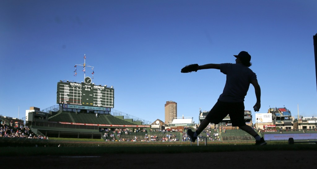Eddie Vedder warms up in the Cubs bullpen before throwing out ceremonial first pitch. AP Photo/Charles Rex Arbogast