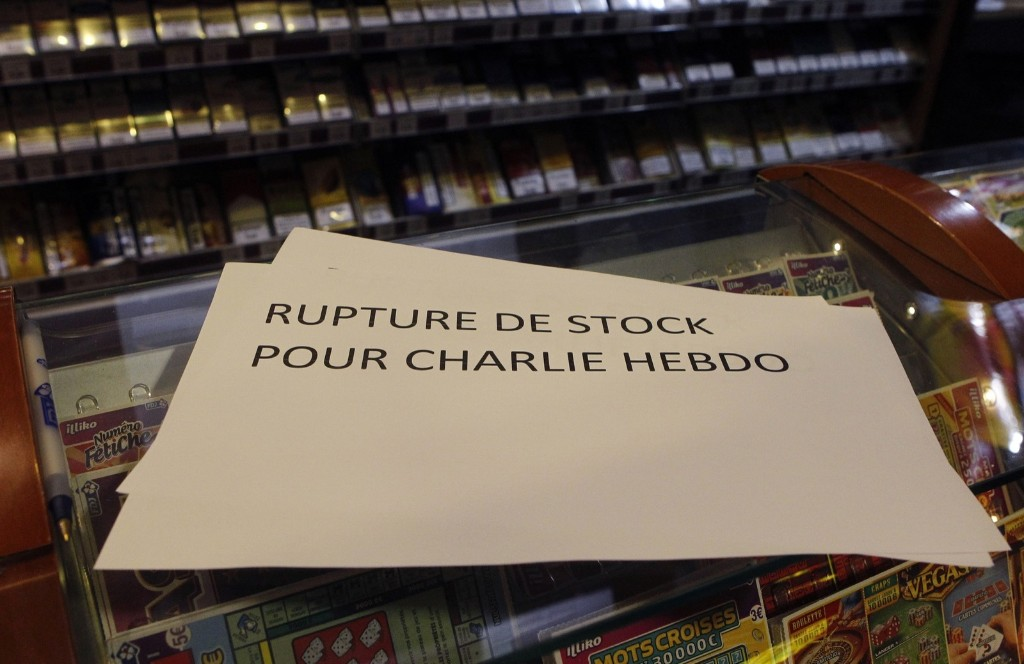 """A banner reading """" Stock shortage for Charlie Hebdo"""" at a newsstand in Lille, France, Wednesday. AP Photo/Michel Spingler"""