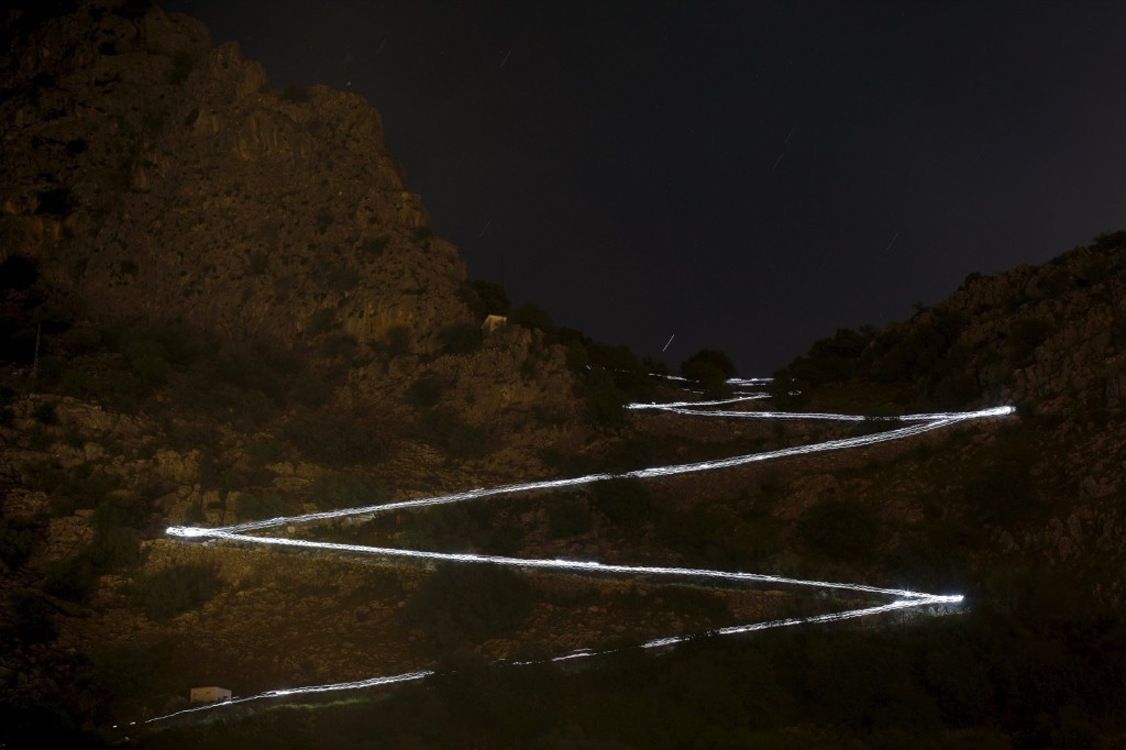 Trails of headlamps as runners descend a mountain towards the finish line during a race on the outskirts of Montejaque, southern Spain. REUTERS/Jon Nazca