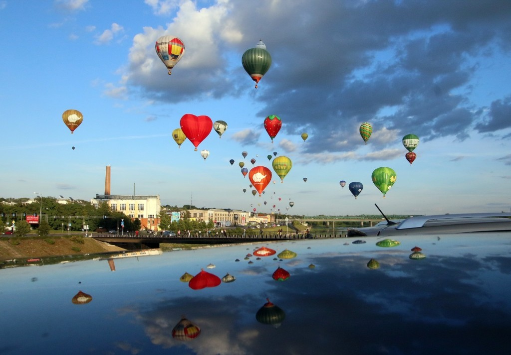 Hot air balloons fly over Kaunas, Lithuania during the International 100 Hot Air Balloon Fiesta Wind of Freedom. PETRAS MALUKAS/AFP/Getty Images