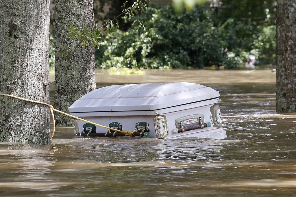 A casket floating in flood waters in Ascension Parish, La. REUTERS/Jonathan Bachman