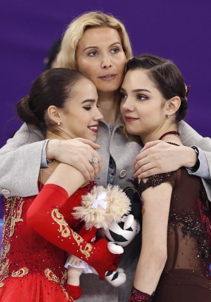 Gold medalist Alina Zagitova and silver medalist Evgenia Medvedeva celebrate with their coach Eteri Tutberidze. REUTERS/Damir Sagolj