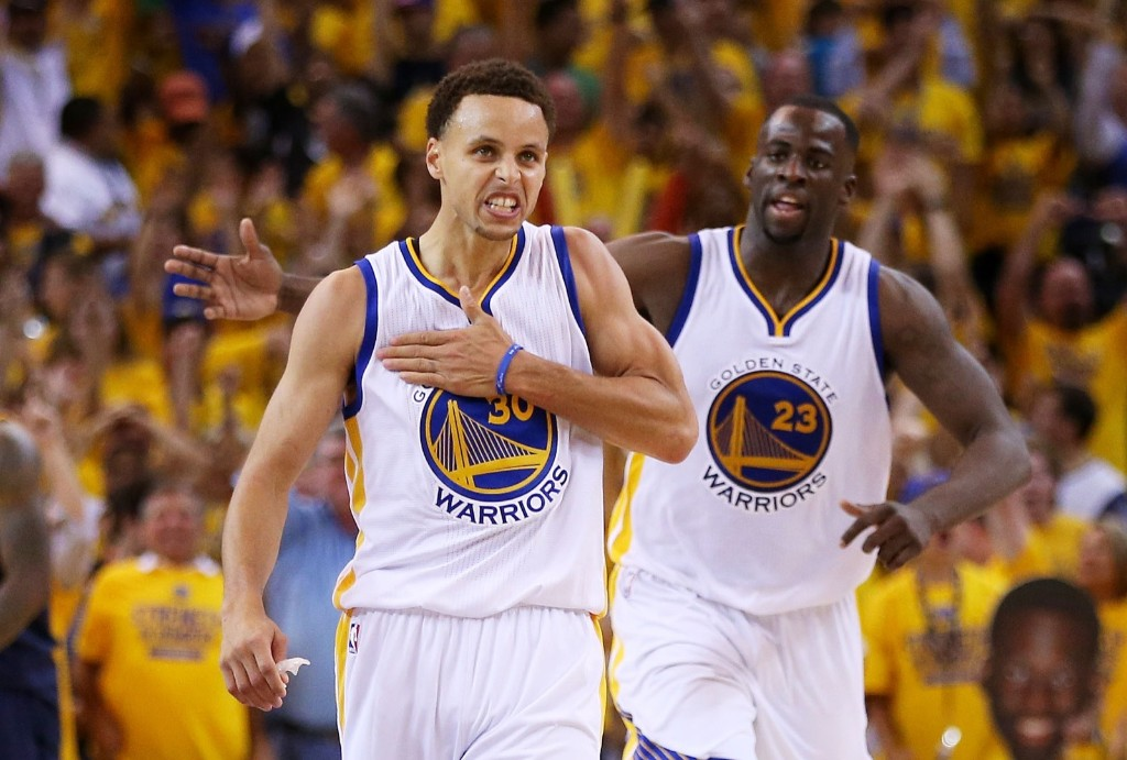 Stephen Curry celebrates with Draymond Green in the fourth quarter. Ezra Shaw/Getty Images