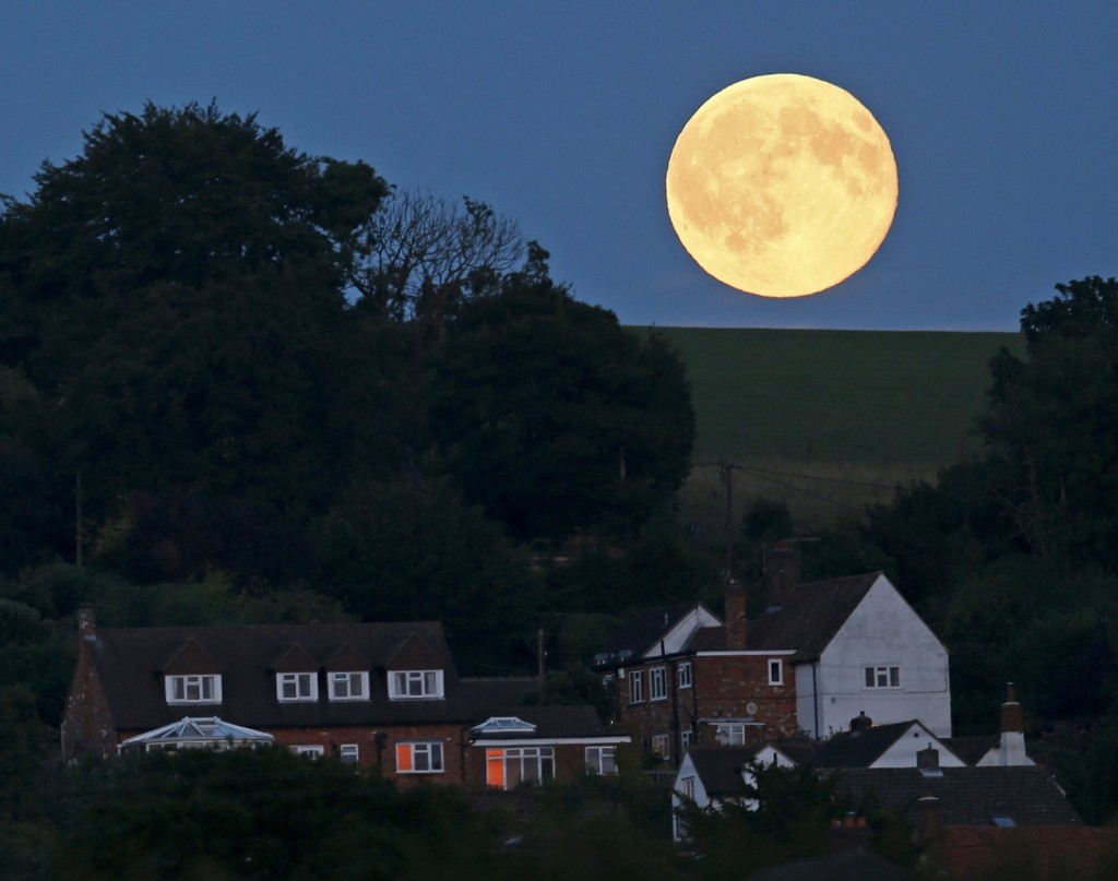 A full moon, known as the Blue Moon, is seen over Loosely Row, near Princes Risborough, southeast England. REUTERS/Eddie Keogh