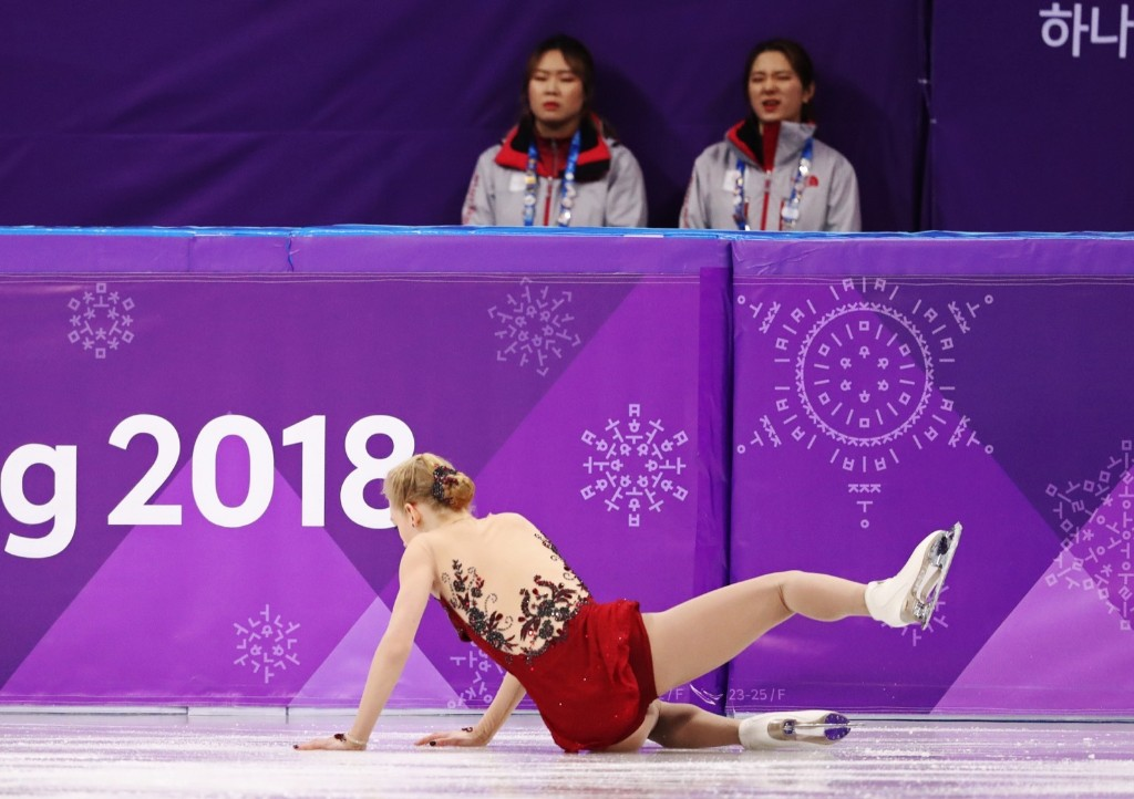 Bradie Tennell of the U.S. falls in the women's short program. REUTERS/Lucy Nicholson