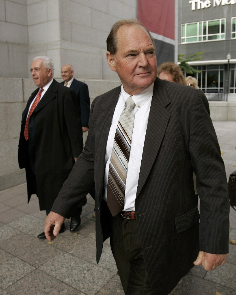 FILE - In this Nov. 2, 2006 file photo, Melvin Dummar and his attorney Stuart Stein, left, arrive at federal court in Salt Lake City. Dummar, a delivery driver who falsely claimed that billionaire Howard Hughes left a handwritten will bequeathing him $156 million, has died in rural Nevada. Nye County Sheriff Sharon Wehrly said Dummar died Sunday, Dec. 9, 2018, under hospice care. He was 74. (AP Photo/Douglas C. Pizac, File)
