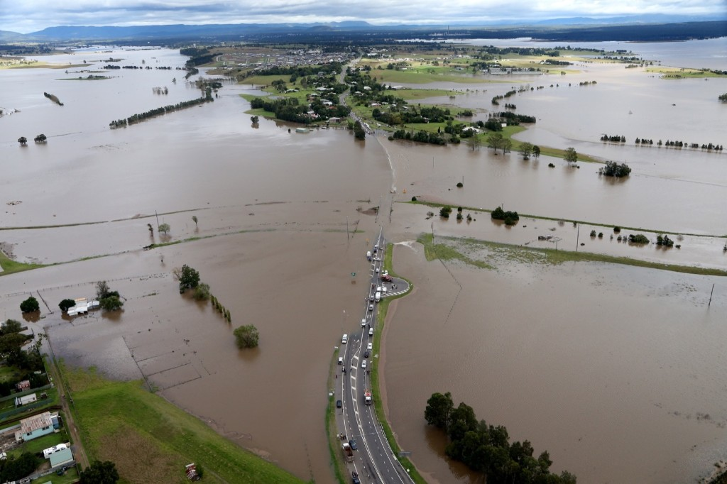 Rescue workers searching for two people who were swept away in a car after torrential rains in Maitland, New South Wales. Adam Taylor/Newspix/Getty Images