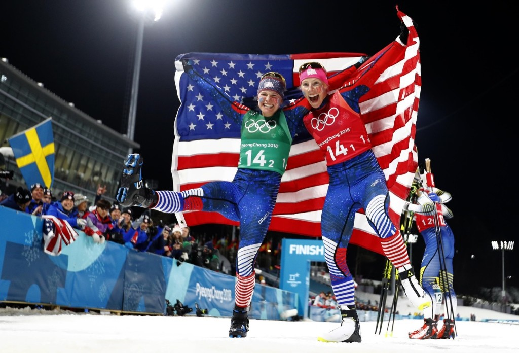 Jessica Diggins and Kikkan Randall of the U.S celebrate winning gold, the first medal ever for the U.S. in women's cross country skiing. REUTERS/Dominic Ebenbichler