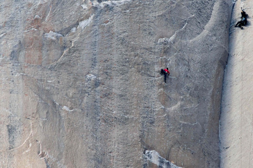 Climber Kevin Jorgeson at Pitch 18 of the Dawn Wall as a cameraman records the climb. REUTERS