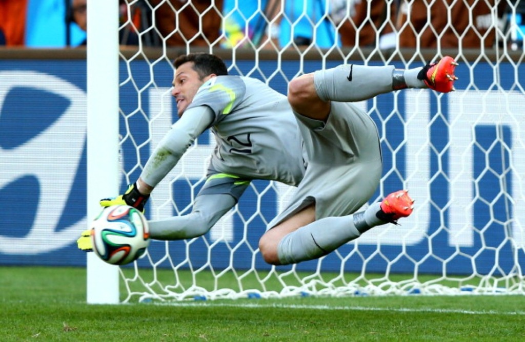 Julio Cesar of Brazil saves a penalty kick from Alexis Sanchez of Chile during shootout. Ryan Pierse/FIFA/Getty Images