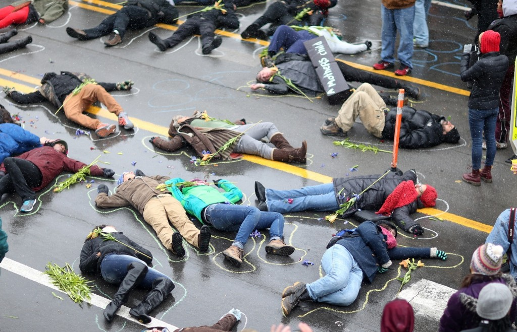 Demonstrators lay on the ground in a mock death protest of the shooting of Michael Brown by a Ferguson police officer in St. Louis. Joe Raedle/Getty Images