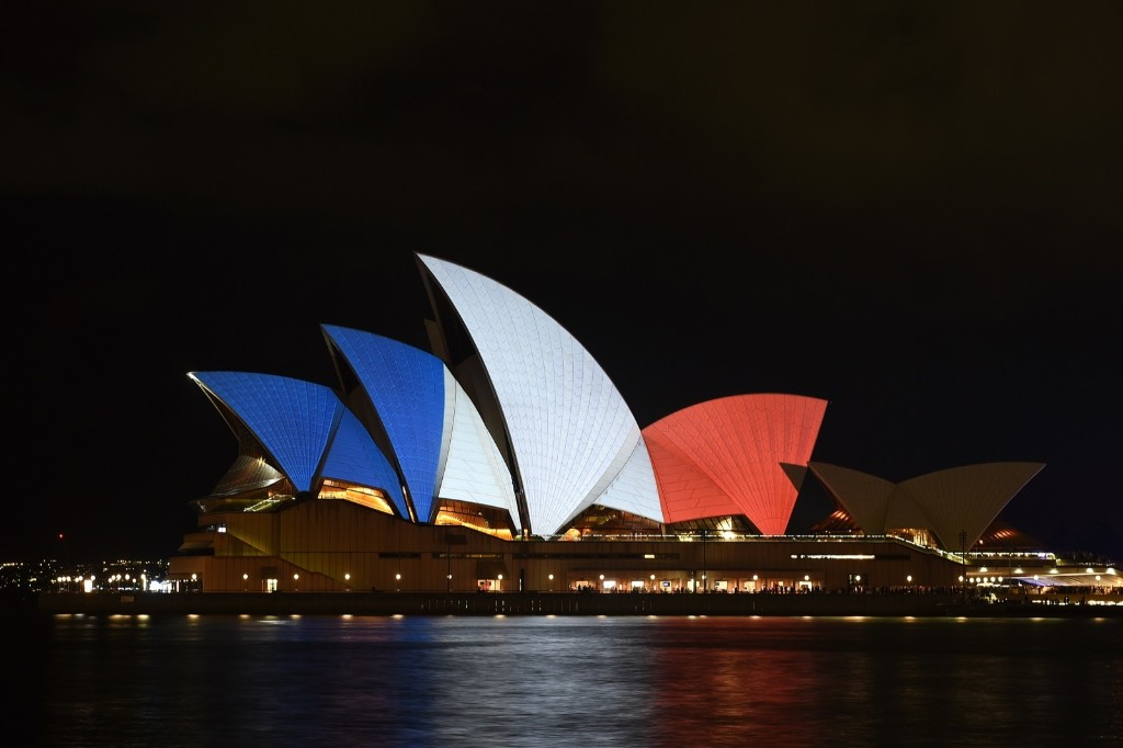 The Sydney Opera House is illuminated in the French national colours in tribute for the victims of the Paris attacks. EPA/DAN HIMBRECHTS