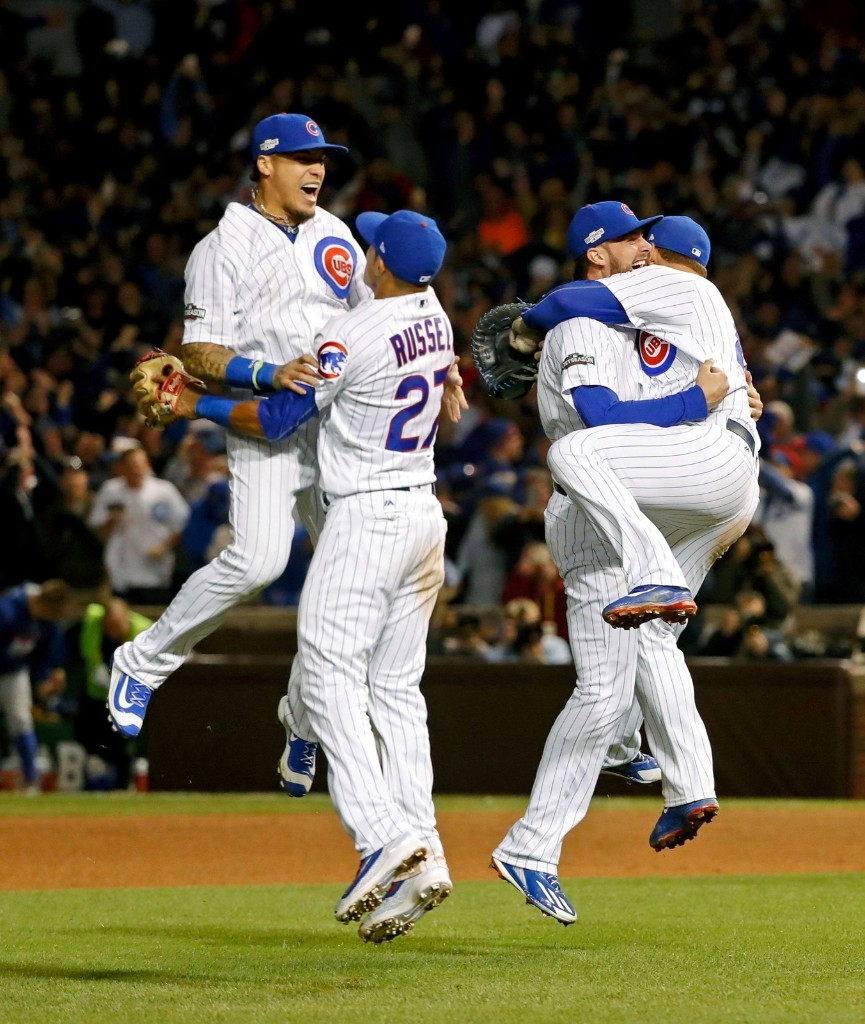 Cubs celebrate after defeating the Dodgers, 5-0, to win Game 6 of the 2016 NLCS playoff baseball series at Wrigley Field. They are making their first appearance in the World Series since 1945. Jon Durr-USA TODAY Sports