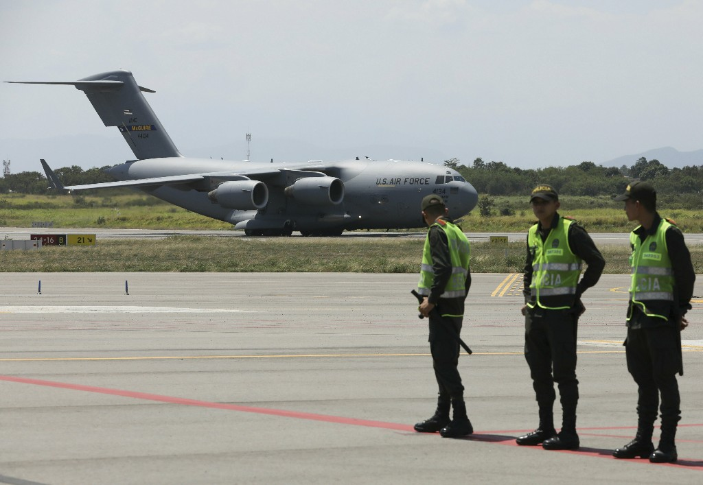 A C-17 cargo plane loaded with humanitarian commodities landed at Camilo Daza airport in Cucuta, Colombia, Saturday, Feb. 16, 2019. The United States is airlifting and pre-positioning additional humanitarian commodities to provide relief to tens of thousands of Venezuelans suffering from severe food and medicine shortages.(AP Photo/Fernando Vergara)