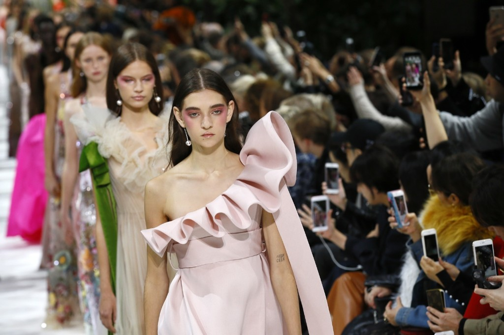 Models wear creations for Valentino Spring/Summer 2018 ready-to-wear fashion. AP Photo/Francois Mori