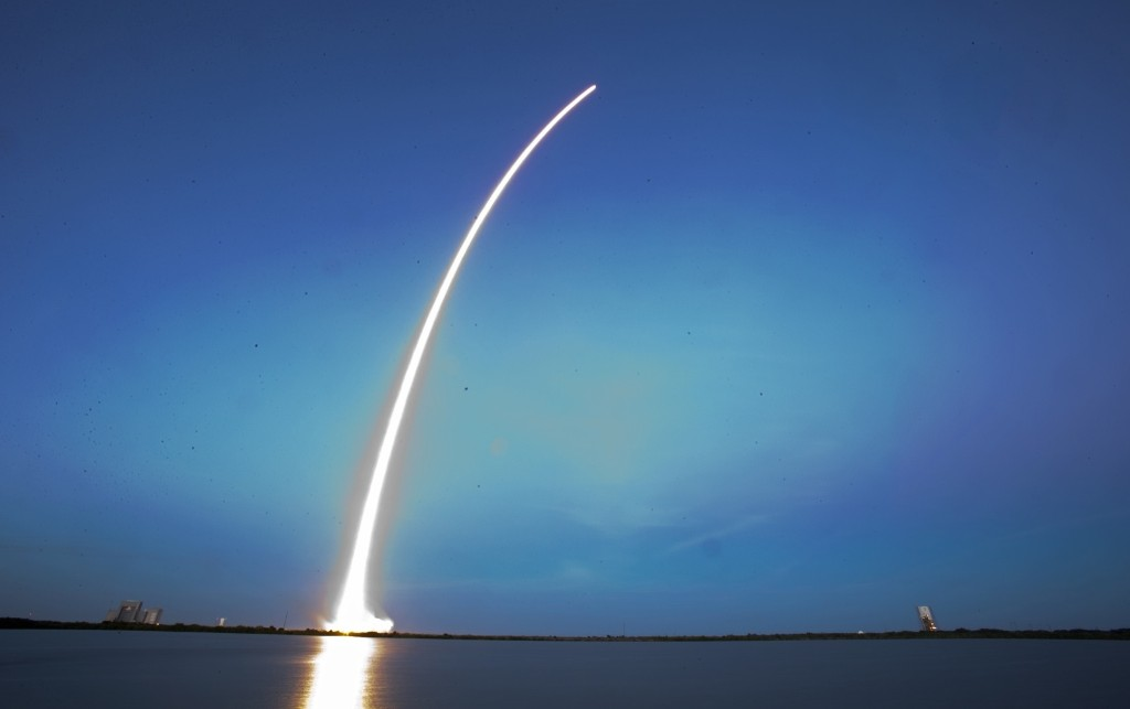 A Falcon 9 SpaceX rocket lifts off from Cape Canaveral Air Force Station, Tuesday. The rocket is carrying its first commercial payload, a communications satellite. AP Photo/John Raoux