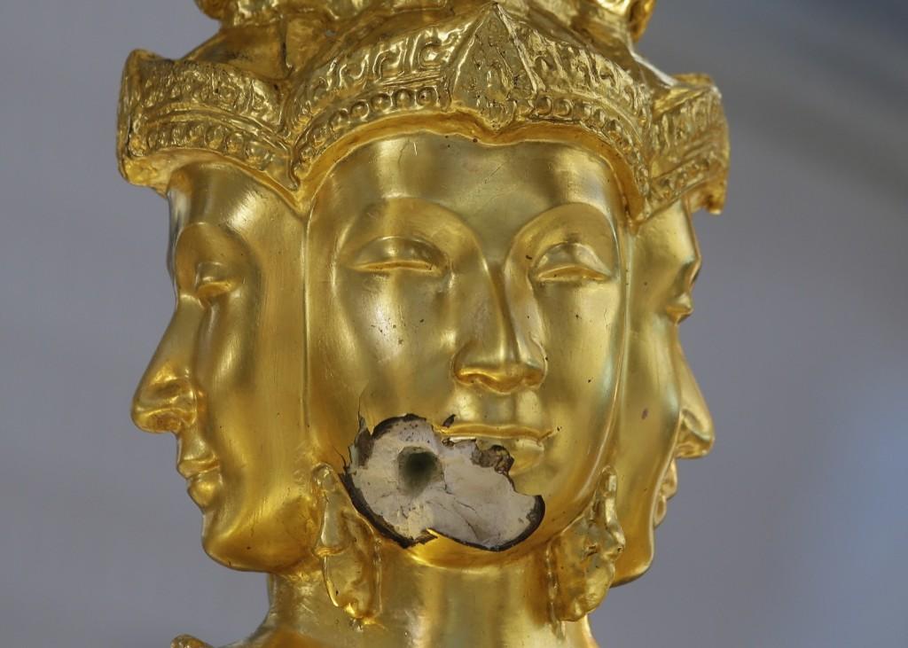 Damage on the statue of Phra Phrom, the Thai interpretation of the Hindu god Brahma, after Monday's bombing at the Erawan Shrine in Bangkok. AP Photo/Sakchai Lalit