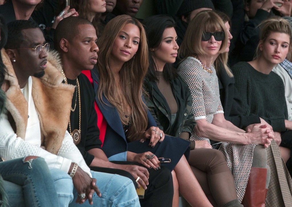 Celebrities Sean Combs, Jay-Z, Beyonce, Kim Kardashian sit with Vogue Editor Anna Wintour during a presentation of Kanye West's Fall/Winter 2015 partnership with Adidas at New York Fashion Week, Thursday. REUTERS/Lucas Jackson