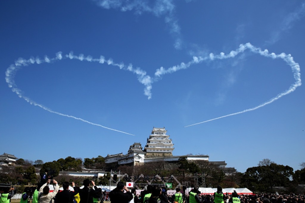 Japan Air Self-Defense Force acrobatic team Blue Impulse performs a maneuver during a commemorative ceremony at Himeji Castle. Buddhika Weerasinghe/Getty Images