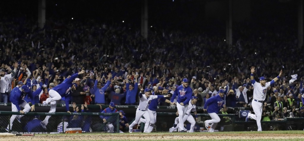 Cubs players celebrate after winning Game 6 and advancing to the World Series against the Cleveland Indians. AP Photo/David J. Phillip