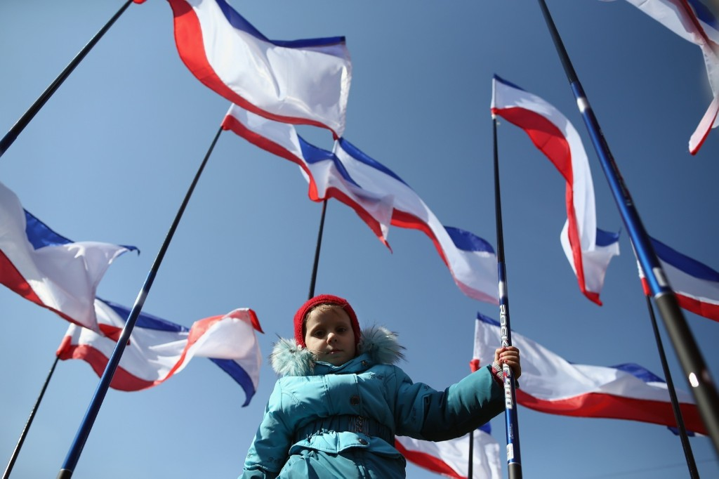 A girl holds a flag during a pro-Russian rally in Lenin Square in Simferopol. Dan Kitwood/Getty Images