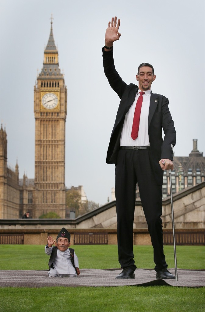 The shortest man, Chandra Bahadur Dangi, meets the world's tallest man, Sultan Kosen, in London. Chandra measures 54.6 cm (21.5 inches); Sultan, 251 cm (8 ft 3 inches). Peter Macdiarmid/Getty Images