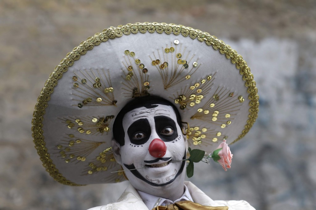 A clown smiles before celebrating Peruvian Clown Day in Lima. Hundreds of professional clowns gather annually on this date to honor the late and beloved Tony Perejil, who died on May 25, 1987. AP Photo/Martin Mejia