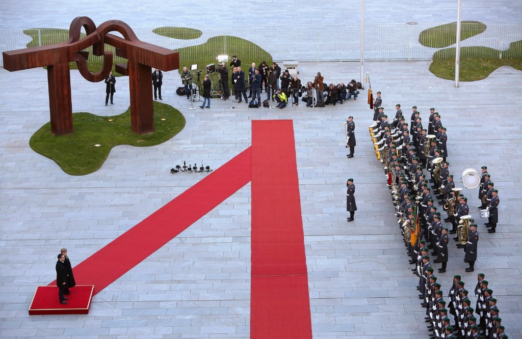 Greek Prime Minister Alexis Tsipras attends a military welcome ceremony with German Chancellor Angela Merkel in Berlin. Adam Berry/Getty Images