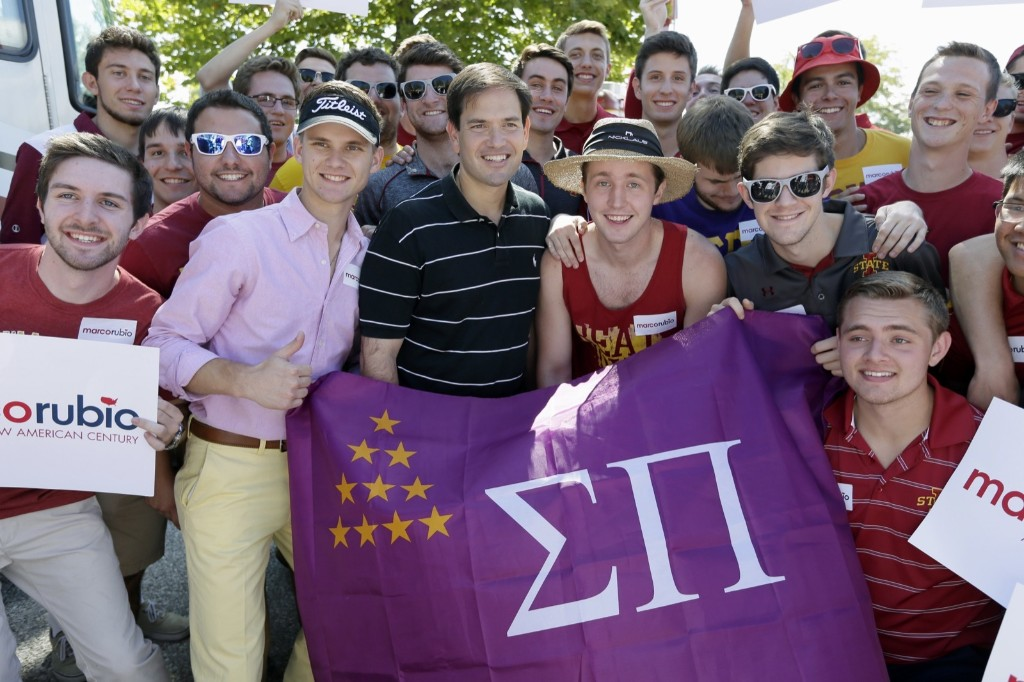 Republican presidential candidate Marco Rubio with fraternity members during a tailgate party before football game between Iowa and Iowa State. AP Photo/Charlie Neibergall