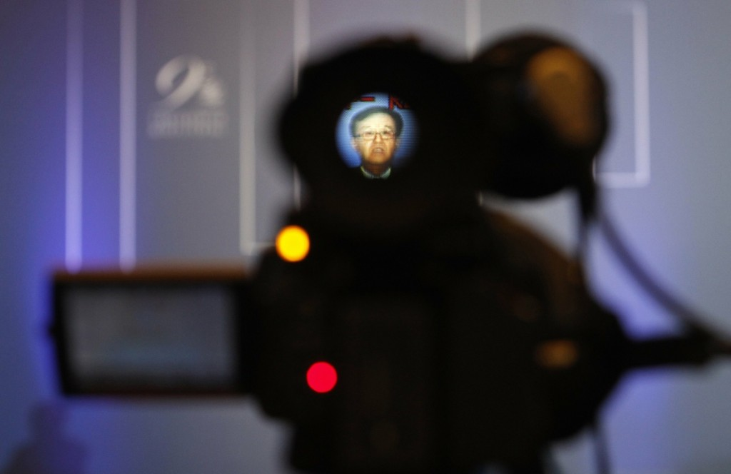 Chinese Commerce Minister Gao Hucheng is seen through a television camera as he speaks at the ninth World Trade Organization Conference in Nusa Dua, on the island of Bali, Wednesday. REUTERS/Edgar Su