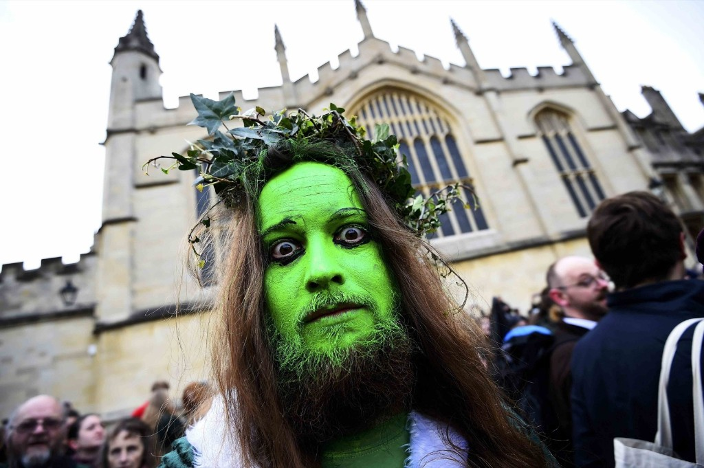 A reveller walks through the streets during traditional May Day celebrations in Oxford, Britain. REUTERS/Dylan Martinez