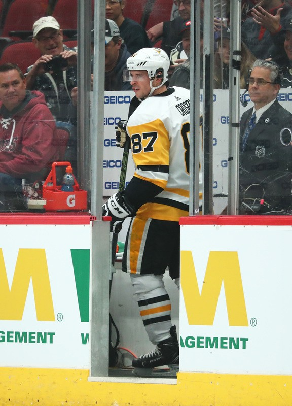 Jan 18, 2019; Glendale, AZ, USA; Pittsburgh Penguins center Sidney Crosby (87) reacts as he goes into the penalty box against the Arizona Coyotes in the first period at Gila River Arena. Mandatory Credit: Mark J. Rebilas-USA TODAY Sports