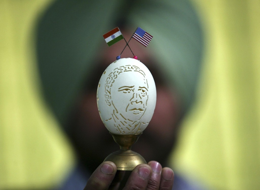Indian artist Harwinder Singh Gill displays his creation, an image of President Obama carved on a duck's egg shell, ahead of Obama's visit to India. REUTERS/Munish Sharma