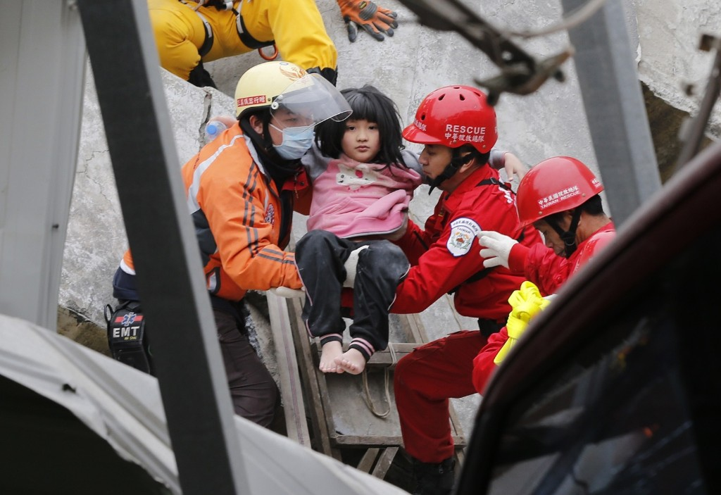 A young girl is rescued from a collapsed building. AP Photo/Wally Santana