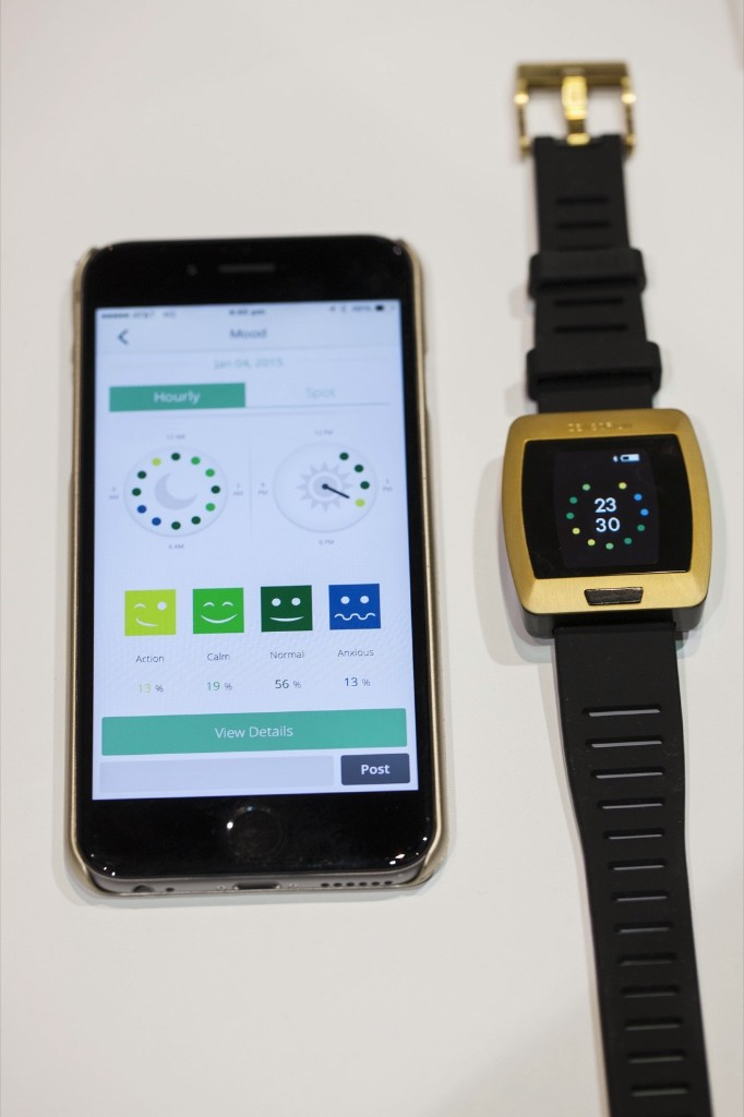 The Zensorium Being activity tracker alongside an iPhone using the Zensorium app. Michael Nagle/Bloomberg/Getty Images