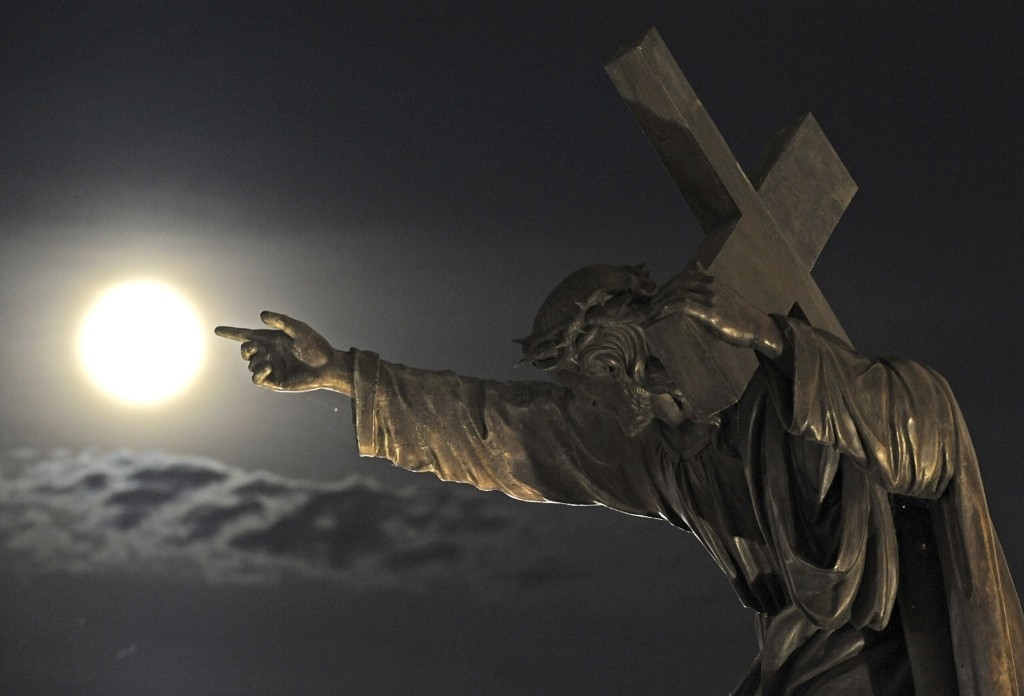 Supermoon rises above the Holy Cross church in Warsaw. AP Photo/Alik Keplicz